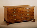 Walnut Veneered Chest Of Drawers