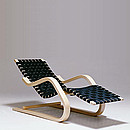 Designer: Alvar Aalto 1936-37 Birch, natural lacquered Seat with linen webbing or black leatherbelts