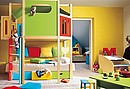 A bedroom in an array of citrus colours, a fun space to grow up in.