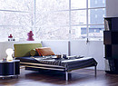 A bed for all nights and days. A very light aluminium bed, which consists of 8 elements that are hold together by a belt. The bed can be easily assembled and dissembled. A bed on rolls � finally...