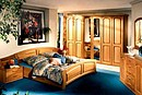 Classic bedroom, manufactured in partial solid oak, natural colour and laqueer finishing.