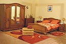 French rustic style bedroom, manufactured in partial solid oak with semi-glossy finishing.