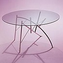 A folding structure-sculpture, a tabletop glass to gasp at such breathtaking architecture, Dole Melipone, one of the earliest designs by Philippe Starck for xO still amazes.