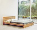 Designer: Philipp Mainzer, 1998 This bed is manufactured from solid wood 40 mm (1 5/8 inch) thick. The frame height is 250 mm (9 7/8 inch) and can be taken apart. The standard model with wooden...