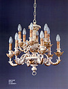 Carved wooden chandelier Classic style with pale gold leaves The line is compact with two floors of lights in a small size. Dimensions: h 50, Ø 60 cm.