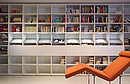 ALPHA NOVA as library with movable reading desk Program ALPHA NOVA Walnut, behind sliding doors Program DELTA Profile series LIGNUM Frames walnut Fronts Parsol gray, glass sandblasted