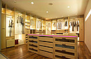 Walk-in-wardrobe par excellence Program SIGMA Shelves, drawers with glass or wooden trims, pull-out shelves,rotating clothes-rack, high pull-out wardrobe and lighting tubes on the back side of the...