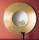 Wood mirror with frame in gold or silver leaf gilding. The gilt and silvering is applied manually using the age old application system of leaves extended on a bole film.