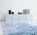 Container with drawers and doors. It can also be placed on the floor even with feet, suspended to the wall or on wheels.
