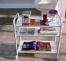 Three levels trolley with aluminium structure and frosted glass shelves.
