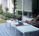 Three square small tables with acidified glass top part. Structure in anodized aluminium.