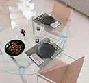Round table with transparent glass top part and anodized aluminium structure.