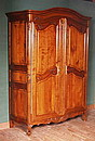 """Louis XV style wardrobe. We notice his curved legs named """"à doucine"""" and his two doors which follow the lines of the """"policemen hat"""" moulding. Solid cherry wood; solid chestnut wood shelves."""
