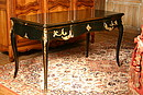 Louis XV style desk, solid wood cut out in the mass, antique black lacquered, composed of three cases sliding shelf.
