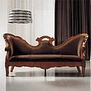 Three seater sofa in solid cherry wood.