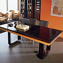 Table in cherry wood and ebony Makassar with two central extensions.