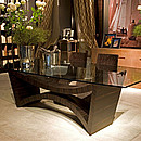 Rectangular table with crystal top and wooden sculpture base in ebony makassar.