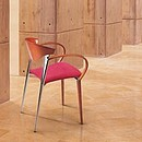 Stackable chairs and armchairs. With metal structure in chrome. Arms in wood or metal.