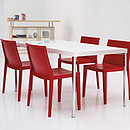 Stackable chair in polypropylene Metal arms.