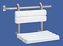 Contina hanging shower seat incorporating ergonomic radiused seat pads. Supplied ready to hang onto grab rail. Grab rail is not included. Anti theft device